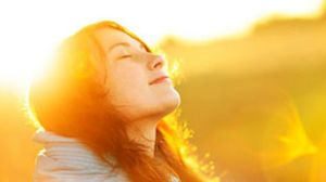 Woman-Smiling-in-Sunlight